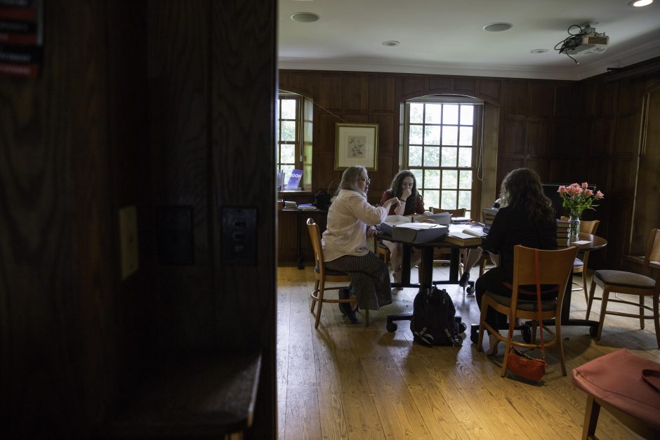 Maureen Sullivan '18, Emma Jean Meyer '19, Jessica Halter '18 , and Professor Leslie Kathleen Hankins work in the Van Etten-Lacey House.