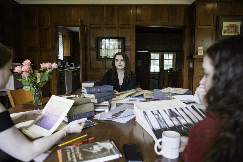 Maureen Sullivan '18, Emma Jean Meyer '19, Jessica Halter '18 , and Professor Leslie Kathleen Hankins work in the Van Etten-Lacey House. 4