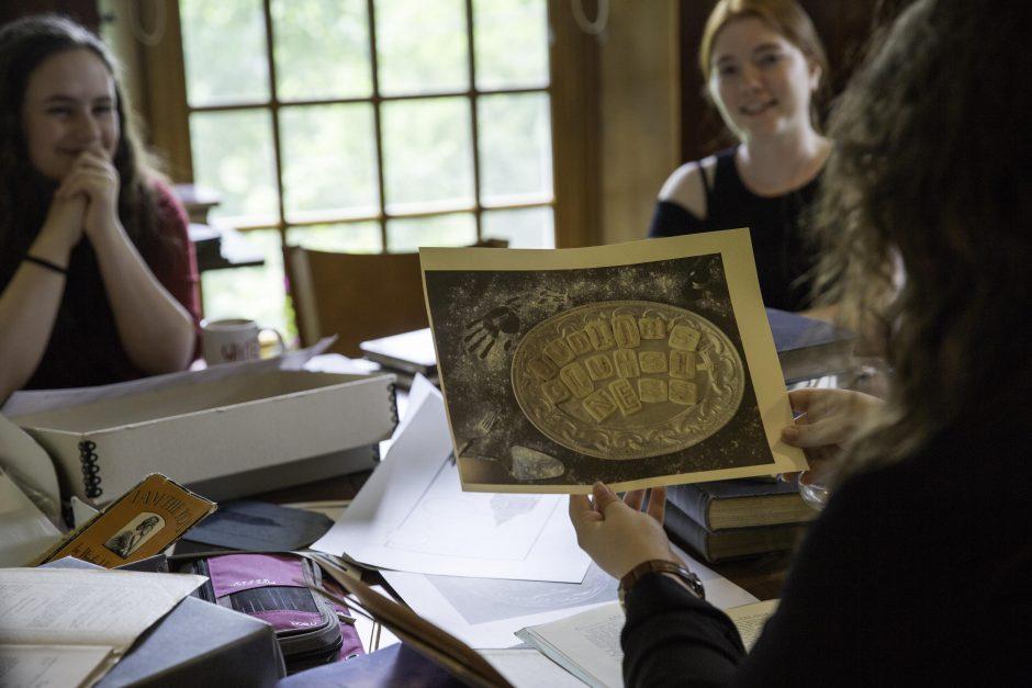 Maureen Sullivan '18, Emma Jean Meyer '19, Jessica Halter '18 , and Professor Leslie Kathleen Hankins work in the Van Etten-Lacey House. 2