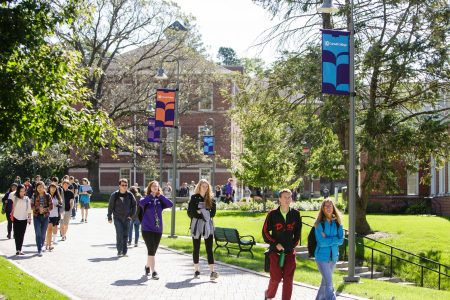 Students walk along the Ped Mall