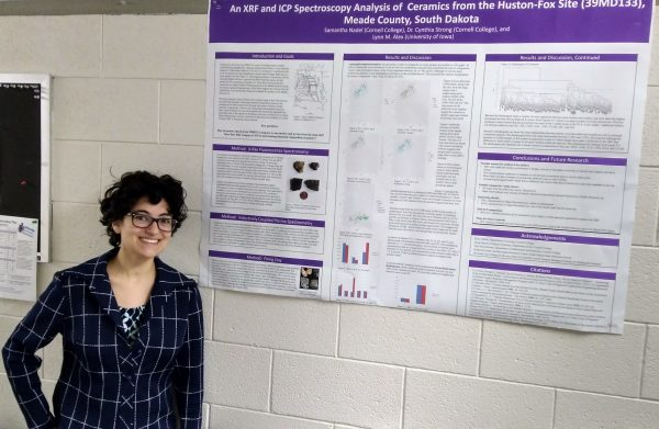 Photo of Samantha Nadel with research poster