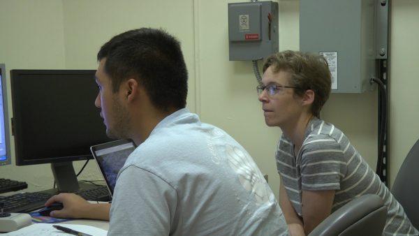 Carlos Tellez works with Professor Emily Walsh.