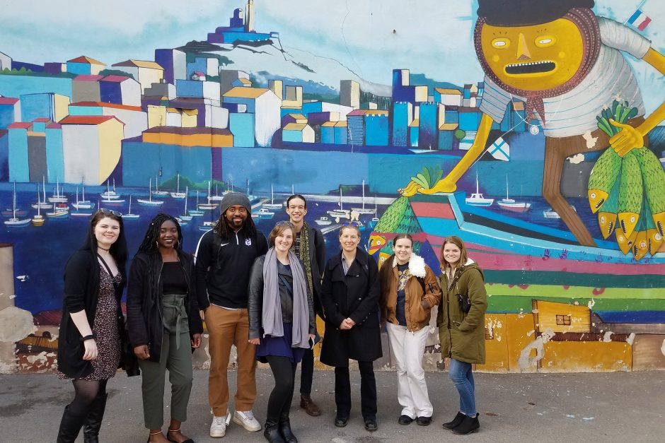 The group in front of a mural in Marseille. The artwork was in the Panier neighborhood of the city, which is the oldest neighborhood in Marseille.