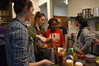 Students make a meal for a women's homeless shelter in Denver during ASB 2017.