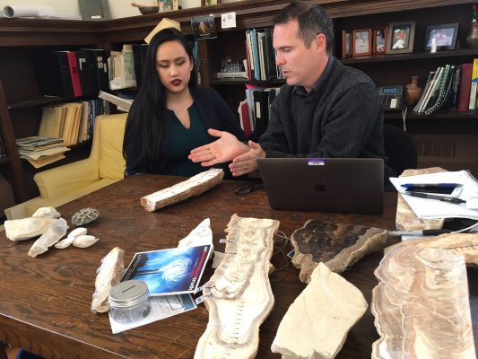 Professor Rhawn Denniston and Huong Quynh Anh Nguyen '19 discussing a stalagmite