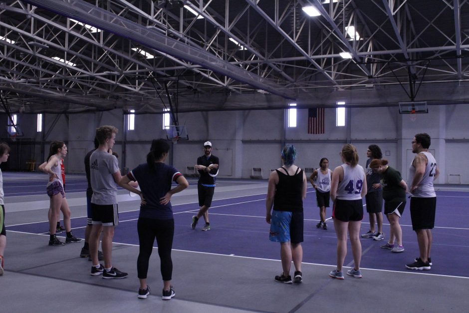 Students playing ultimate frisbee