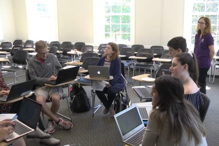 Photo of students and professor in a classroom