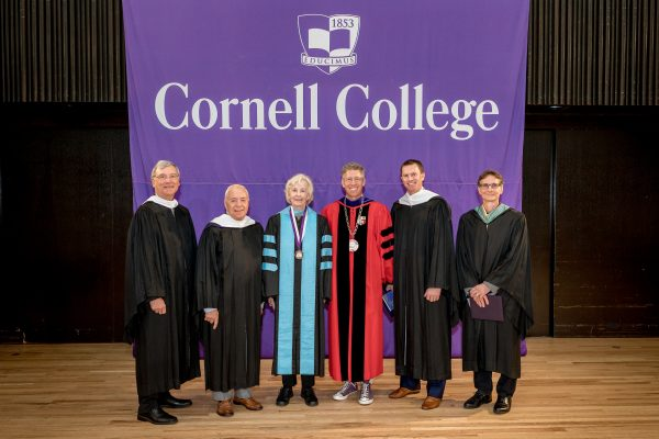 (left to right) John Toussaint '78, Doug Michaels '64, Dorothy Ashbacher Lincoln-Smith '58, Eric Sudol '03, Kenneth Patterson '83 in front of Cornell College banner