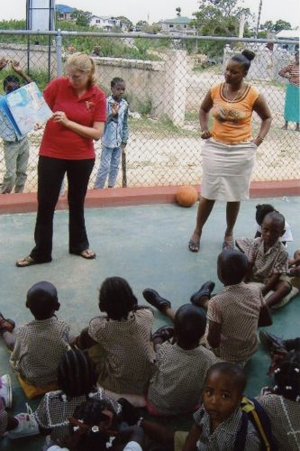"Jessa Harger '03 reads Dr. Seuss' ""The Lorax"" to children at Thompson Town Basic School in Trelawny, Jamaica."