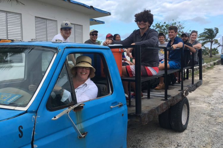 Professor Stewart drives students in the Bahamas.