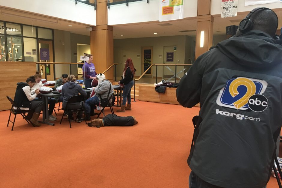 KCRG photographer takes video of student working on service projects