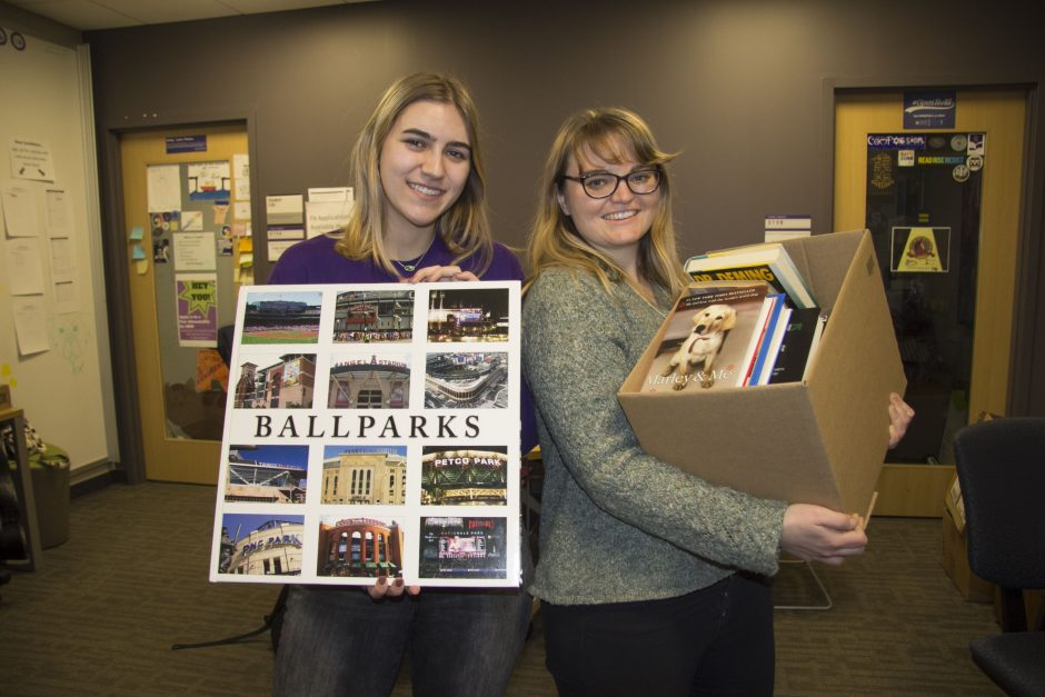 Lexi Woywod '21 (left) and Hannah Ganzel holding books