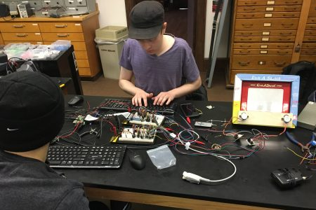 Nick Duesing '20 works to create a computer-controlled Etch A Sketch in his engineering class