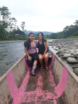 Guerra sitting in a canoe with a second woman.