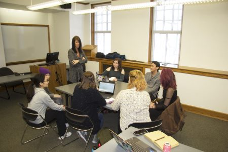 Melinda Green meets with her Cornell student team for research updates