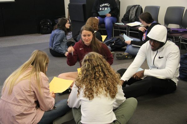 Cornell students work in groups with high school students
