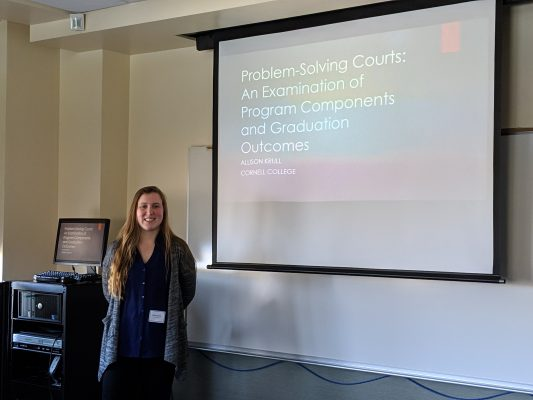 Allison Krull standing by her presentation