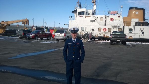 Ryan Wiley by a Coast Guard Ship