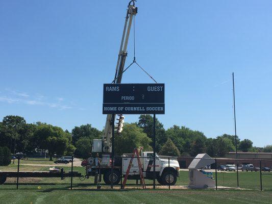 Photo of crane holding up new scoreboard