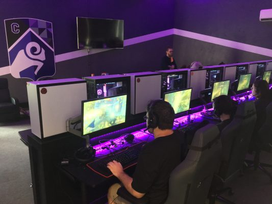 Esports arena and students playing video games