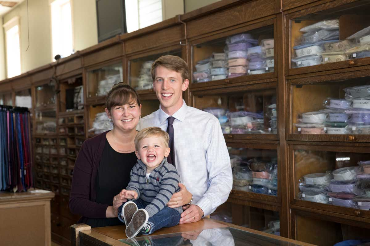 Olivia Cotton Randall '13 and Josh Randall '14, seen with their son Paul