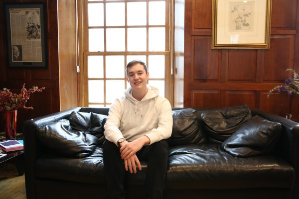 Sophomore Connor Kenney sits in Van Etten-Lacey House, home to Cornell's Center for the Literary Arts.
