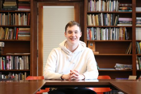 Sophomore Connor Kenney inside Van Etten-Lacey House.