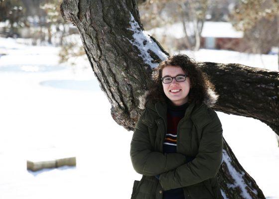 Natalie Bradshaw stands near Ink Pond on Cornell's campus.