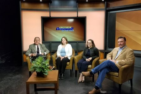 """four people sitting on a tv set for """"Ethical Perspectives"""""""