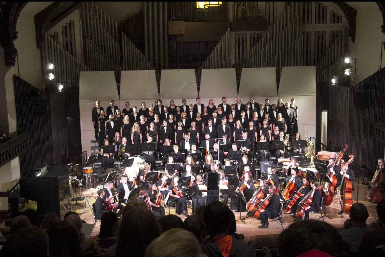 orchestra and choir combined concert on stage