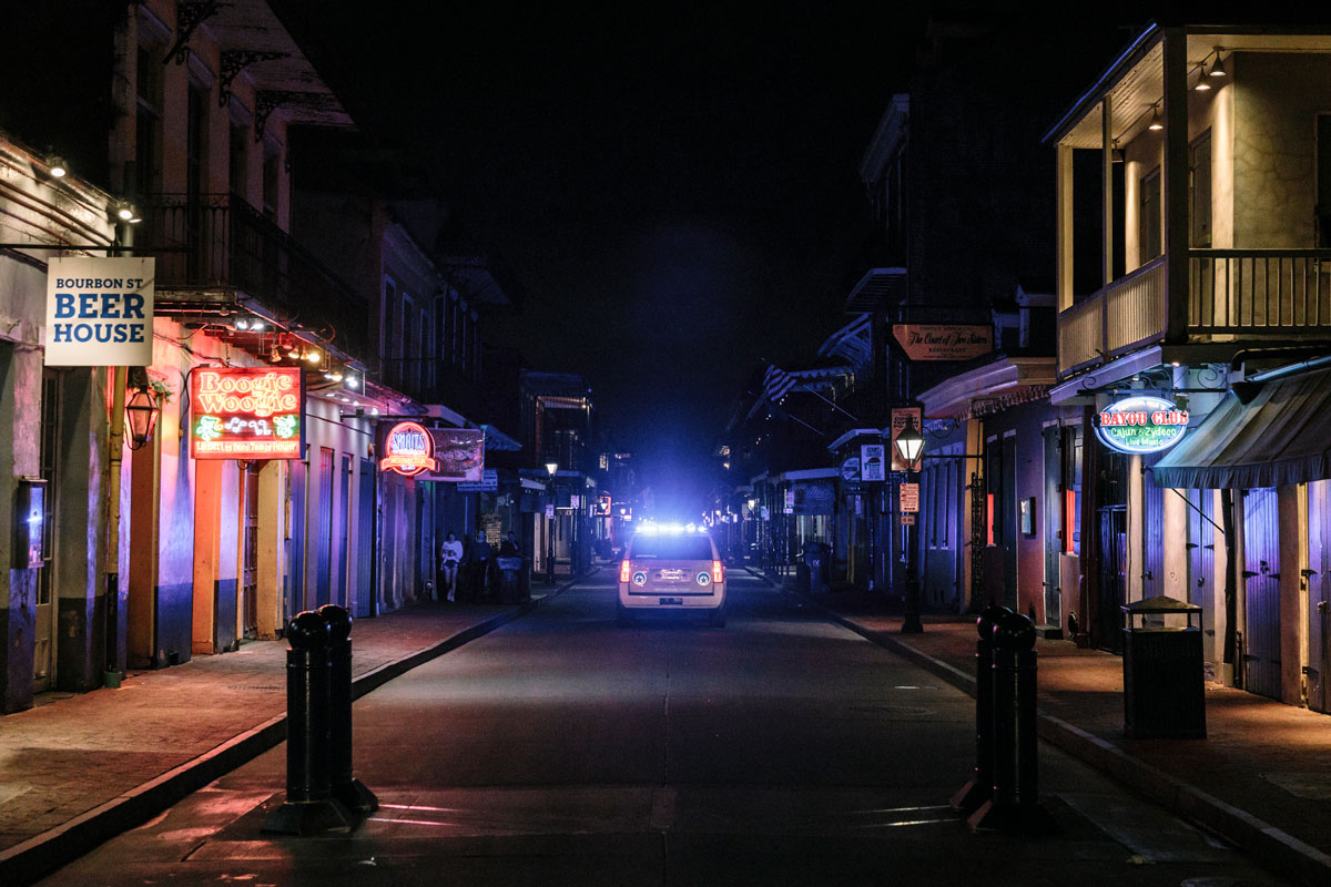 Will Widmer '04 photographed a mostly deserted Bourbon Street in downtown New Orleans on March 18 for the New York Times. Local and state law enforcement vehicles patrol the area using loudspeakers to encourage locals to go home, and tourists to return to their hotels.