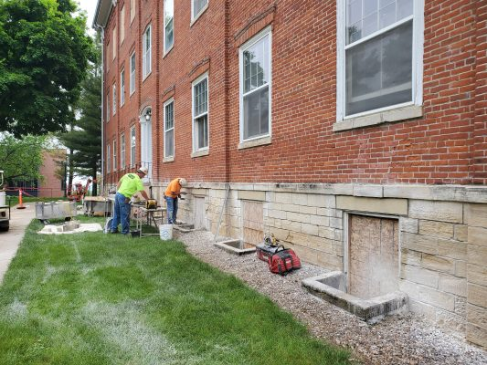 Working on the stones on College Hall