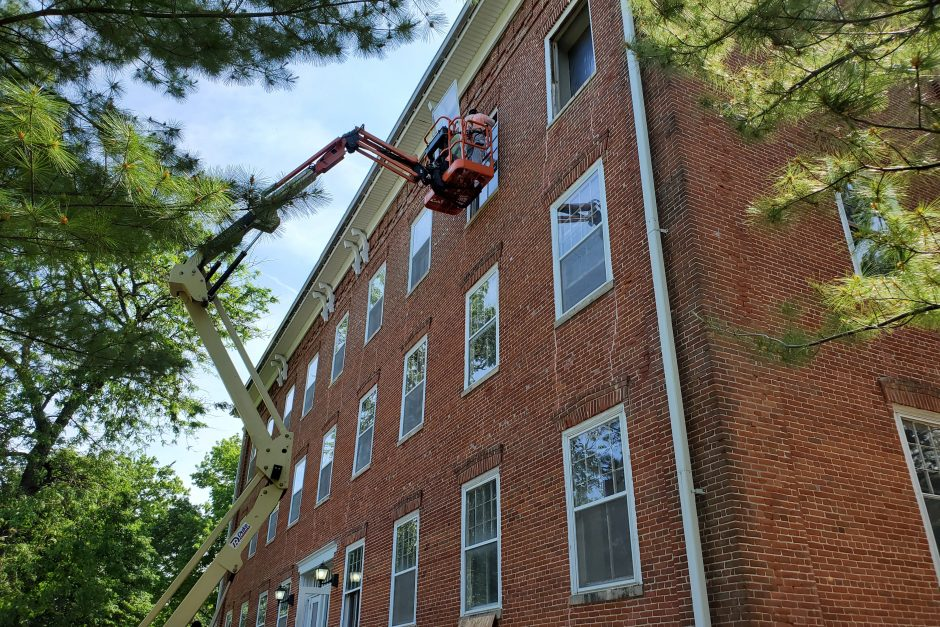 Workers putting in windows in College Hall