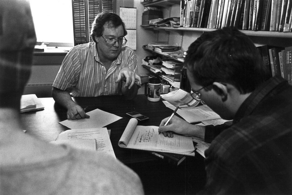 Jerry Savitsky works with students in his College Hall office in 1997.