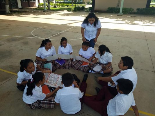 Middle students hold a copy of the Dresden Codex in the Maya town of Calotmul, Yucatan, Mexico.