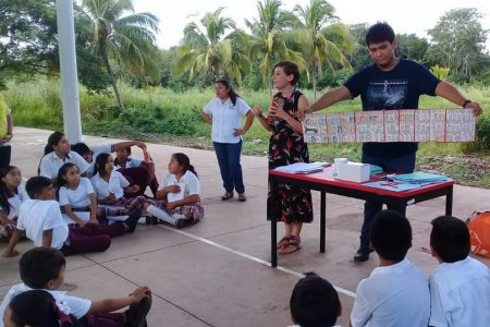 Landry-Montes teaches middle school students in the Maya town of Calotmul, Yucatan, Mexico, about the Dresden Codex, an ancient Maya book.