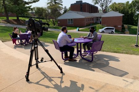 TV reporter interviewing student