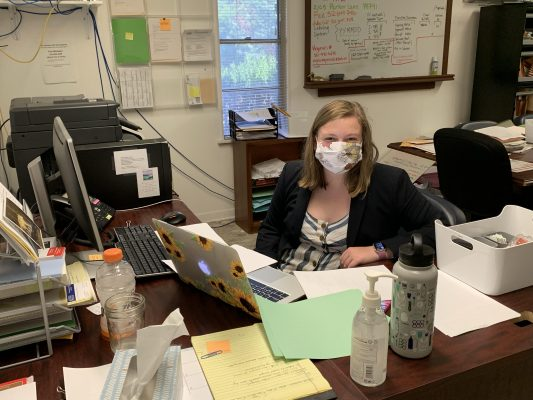 Brena Levy working at her desk
