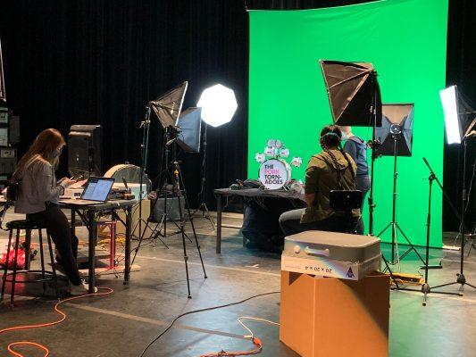 Maggie McClellan (left), Camille Wong, and Regen Kuker preparing for a puppet video shoot.
