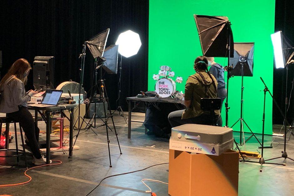 Maggie McClellan (left), Camille Wong, and Regen Kuker preparing for a puppet video shoot
