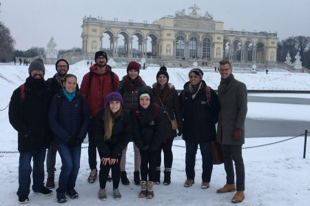 Professor Tyler Carrington (right) with his class at the Schönbrunn Palace in Vienna.