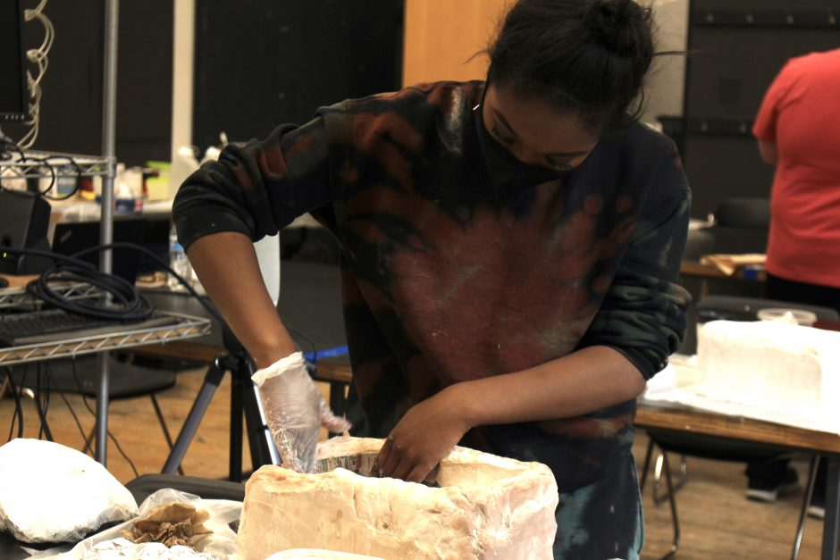 Students are working on a series of projects in their Art 2020 course. They are investigating current social, political, and cultural themes through visual artwork this block. In these photos you can see students working on their Sculptural Mask Project.