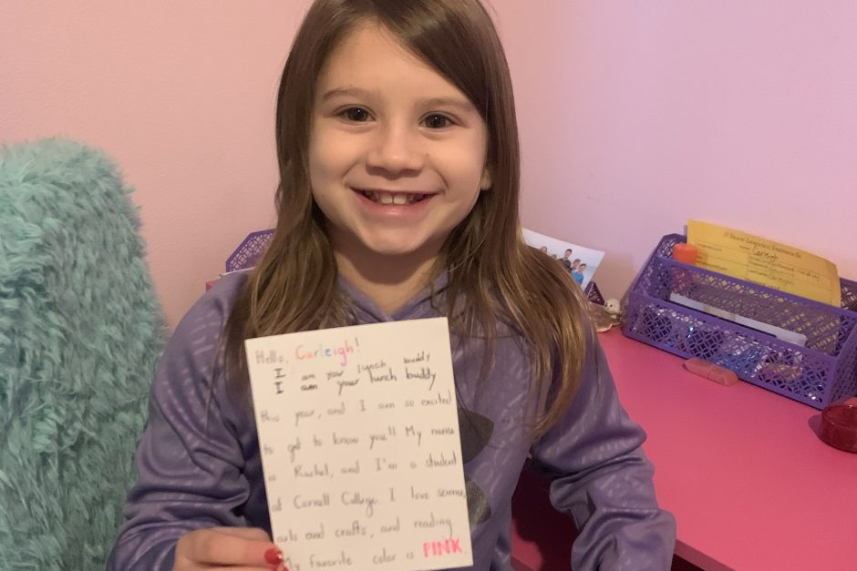 Third grader Carleigh Haugse with a letter from her buddy Rachel Wadkins '21