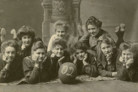 Members of the 1902 Cornell women's basketball team, which beat Coe in the first women's intercollegiate game. The women are wearing bloomers.