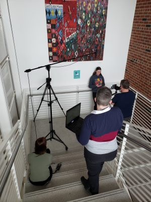 From left to right: Maggie McClellan, West, Josie Wulf, and Scott Olinger filming and recording Wulf's spoken word.