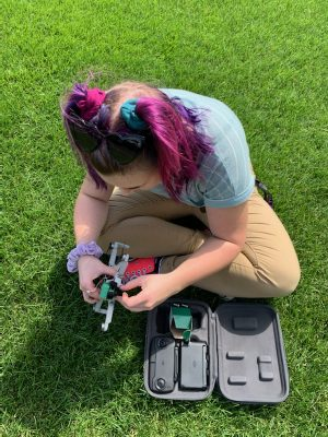 Flannery Henke-Haney testing a drone