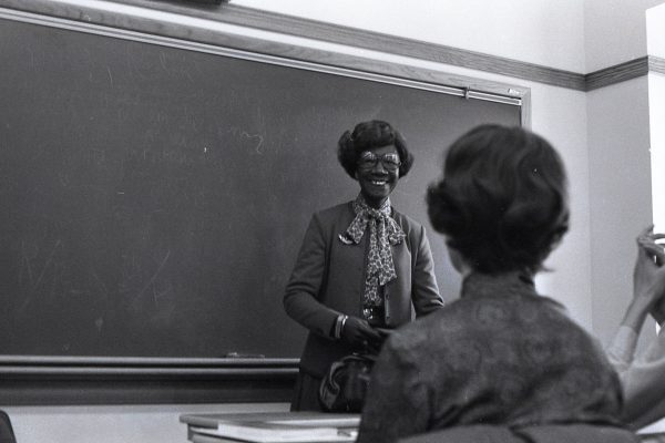 "While on campus Jan. 21, 1982, for a King Chapel lecture on ""Setting National Priorities,"" Shirley Chisholm speaks to a group, possibly a politics class and guests, in South Hall."