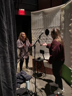 Musical Director, Janelle Lauer (left) is coaching Sophia Mitchell during a vocal recording session. (Photo by: Maggie McClellan.)