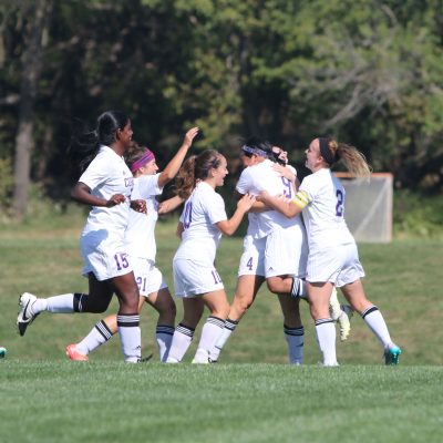 Cornell women's soccer players share their enthusiasm after scoring a goal during a home match in 2015.