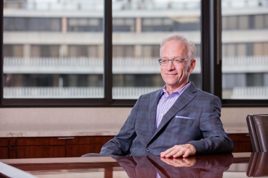 photo of Scott Simmer at an office desk